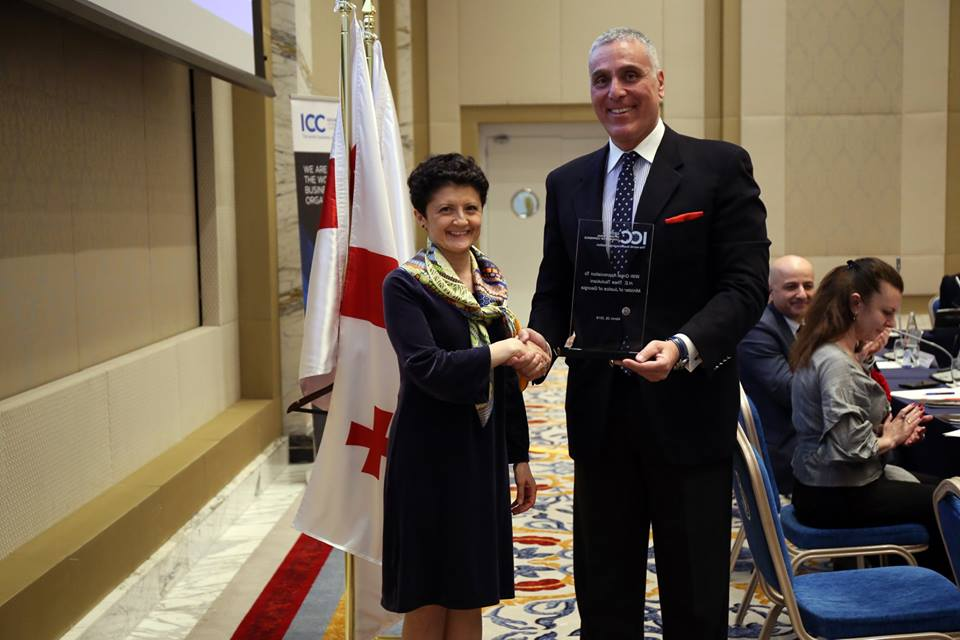 Mr. Fady Asly Chairman of ICC-Georgia remitting the ICC Trophy to H.E. Tea Tsulukiani Minister of Justice of Georgia.